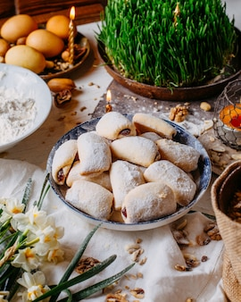 Side view of traditional azerbaijan holiday cookies mutaki on the rustic with nuts