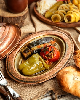 Side view a traditional azerbaijani dish meat dolma from vegetables bell pepper tomato and eggplant