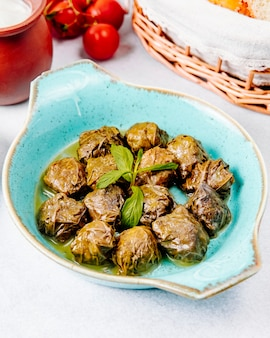 Side view of traditional grape leaves dolma on the table