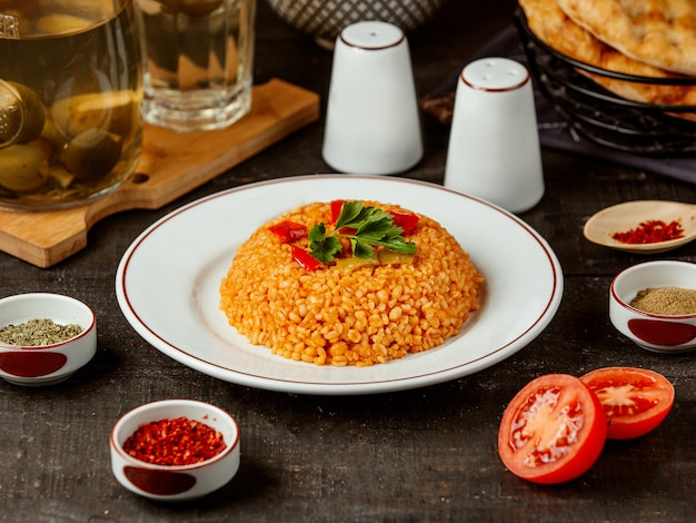 Side view of turkish cuisine bulgur with vegetables on plate