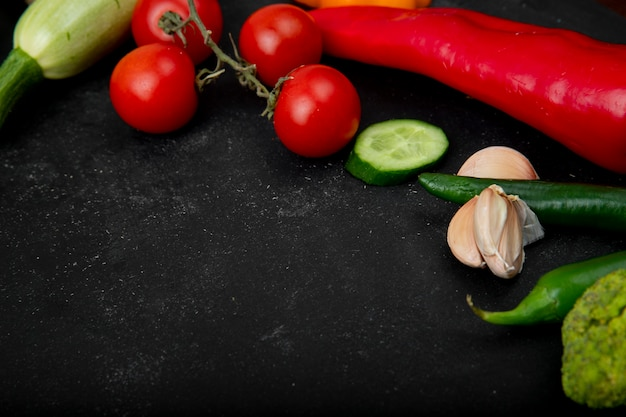 Side view of vegetables on black background