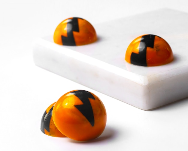 Side view of white chocolate halloween candies on white