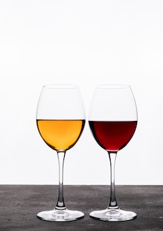 Side view wine in glasses on white vertical