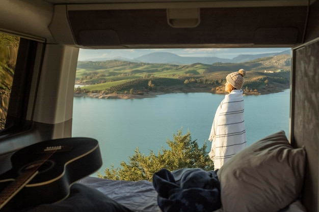 Side view of woman admiring nature while on a road trip