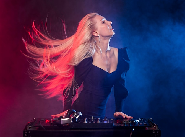 Side view woman at dj console