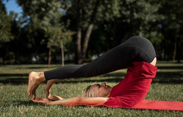 Side view of woman doing yoga position outdoors