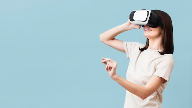 Side view of woman enjoying virtual reality headset