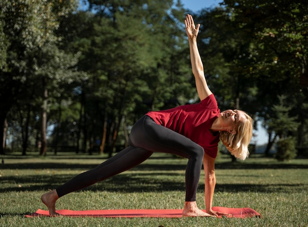 Side view of woman exercising yoga position outdoors