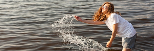 Side view of woman having fun in the water with copy space