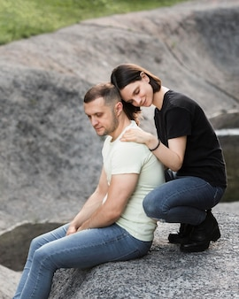 Side view woman holding man