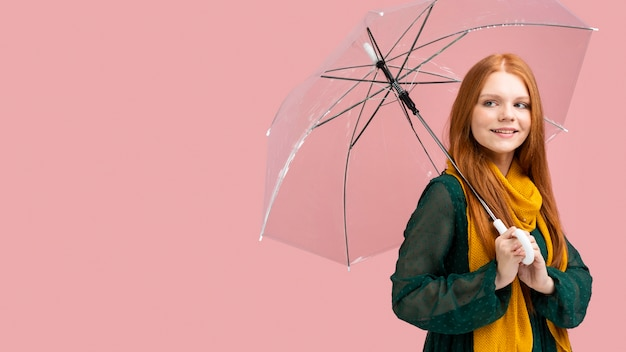Side view woman holding umbrella