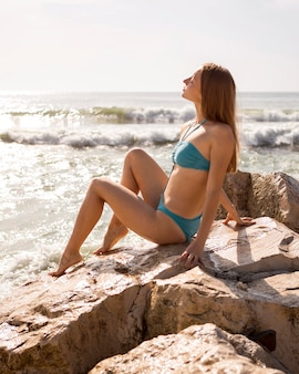 Side view woman posing in swimsuit