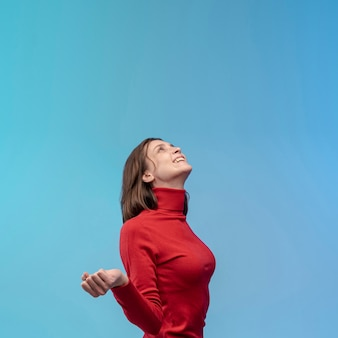 Side view of woman posing while looking up