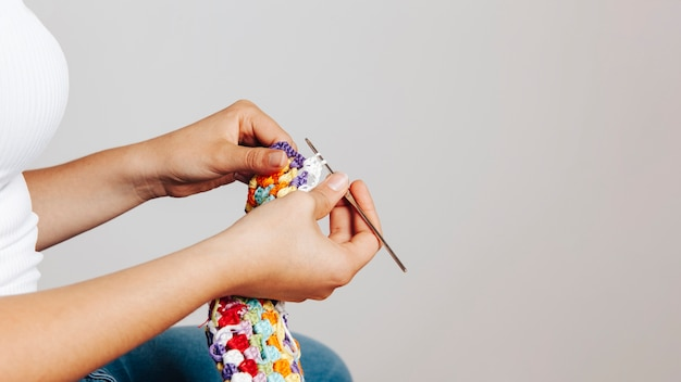 Side view of woman sewing