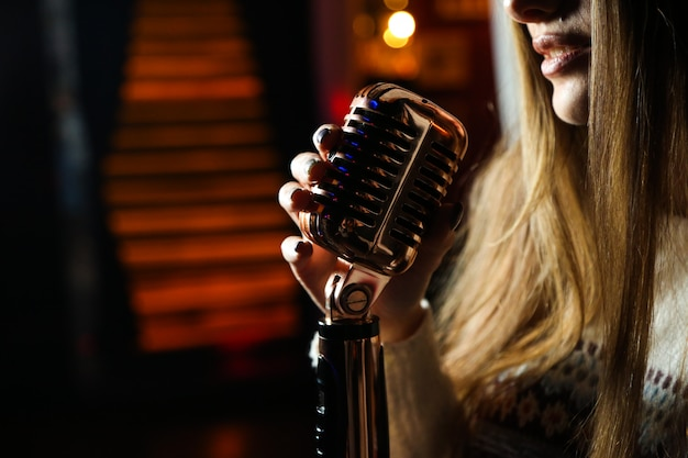 Side view woman singing microphone