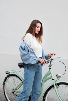 Side view of woman sitting on her bike
