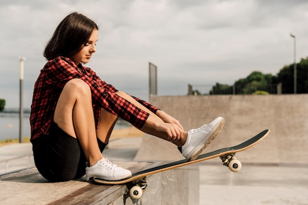 Side view of woman at skate park