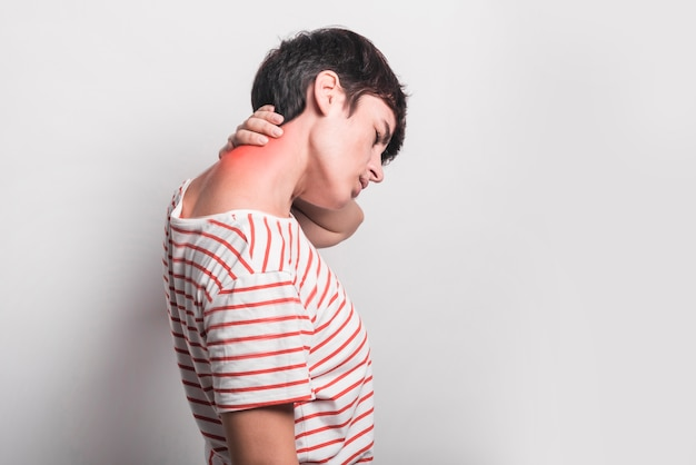 Side view of woman suffering from neck pain isolated on white background