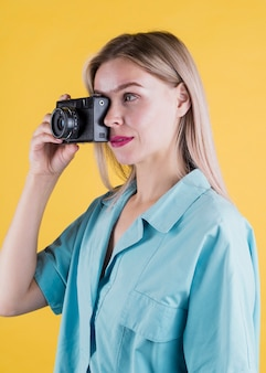 Side view of woman taking photo