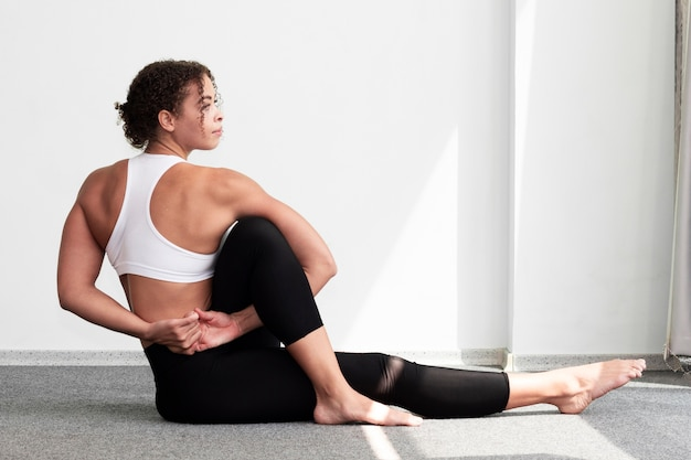 Side view woman training indoors