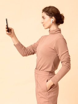 Side view woman using air pods