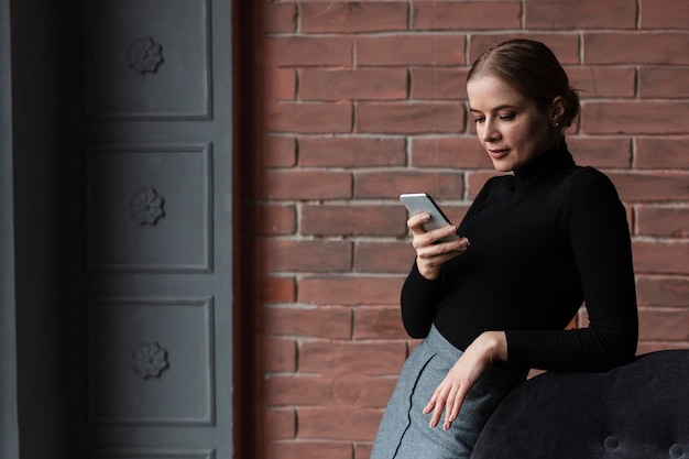 Side view woman using mobile