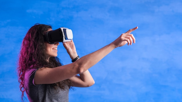 Side view woman using a vr set