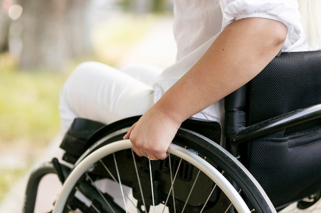 Side view of woman in wheelchair