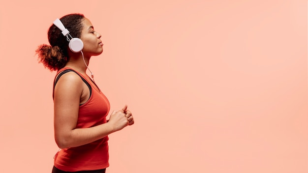 Side view woman with headphones