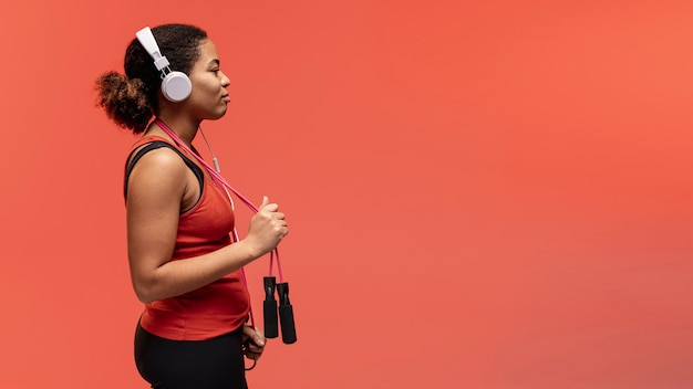 Side view woman with jumping rope