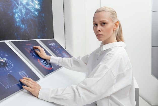 Side view woman working on digital monitors