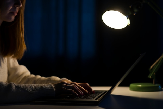 Side view of woman working on laptop