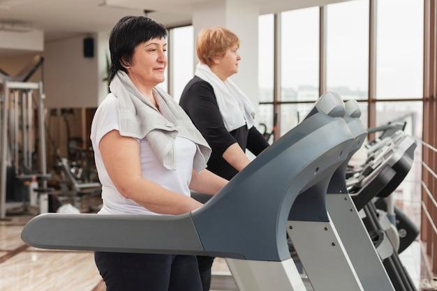 Side view women on treadmill