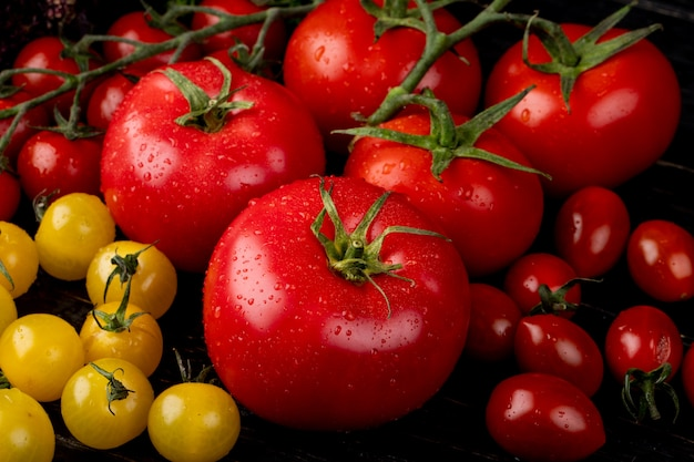 Side view of yellow and red tomatoes