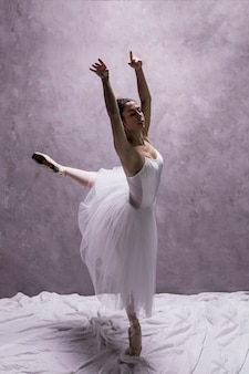 Side view young ballerina performing