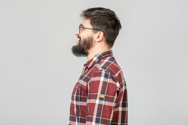 Side view of young bearded man isolated