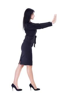 측면보기. 중지 제스처를 보여주는 젊은 비즈니스 우먼. 흰색 배경에 고립