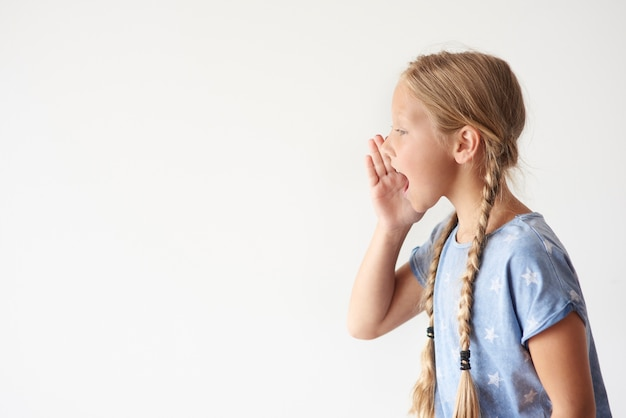 Side view of young girl shouting