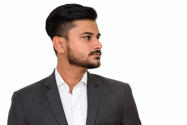 Side view of young handsome indian businessman