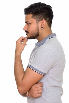Side view young handsome indian man thinking