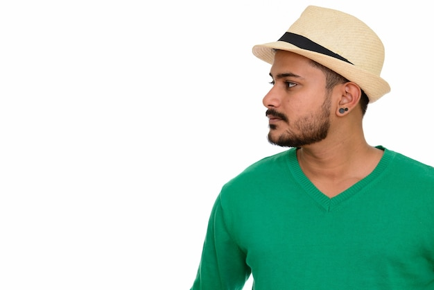 Side view of young handsome indian man with hat
