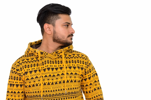 Side view of young handsome indian man