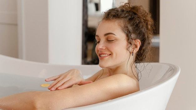 Side view young woman in bathtub