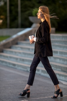Side view young woman walking away