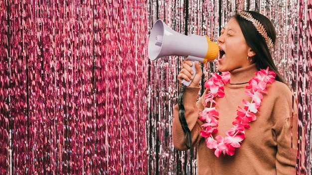 Side view young woman with megaphone at carnival party