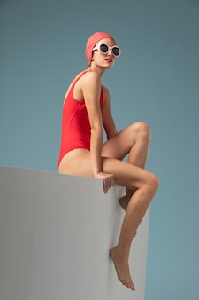 Side view young woman with red swimsuit