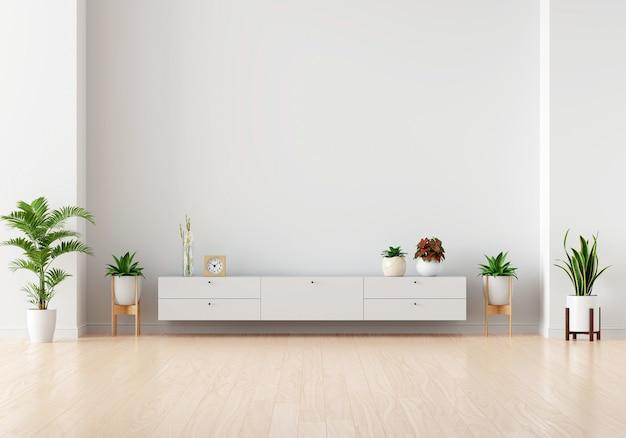 모형을위한 흰색 거실에 녹색 식물이있는 찬장