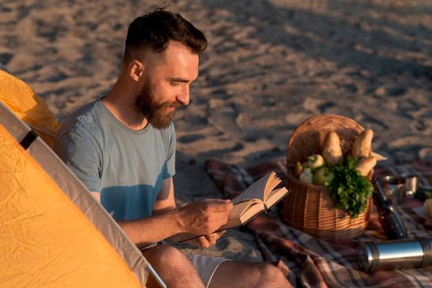 Sideways adventurer sitting and reading
