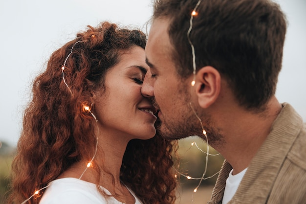Sideways couple kissing outdoors