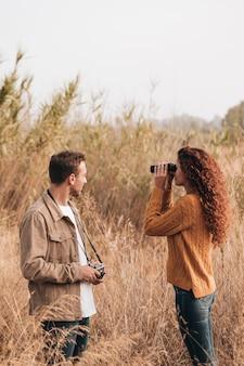 Sideways couple standing in wheat field